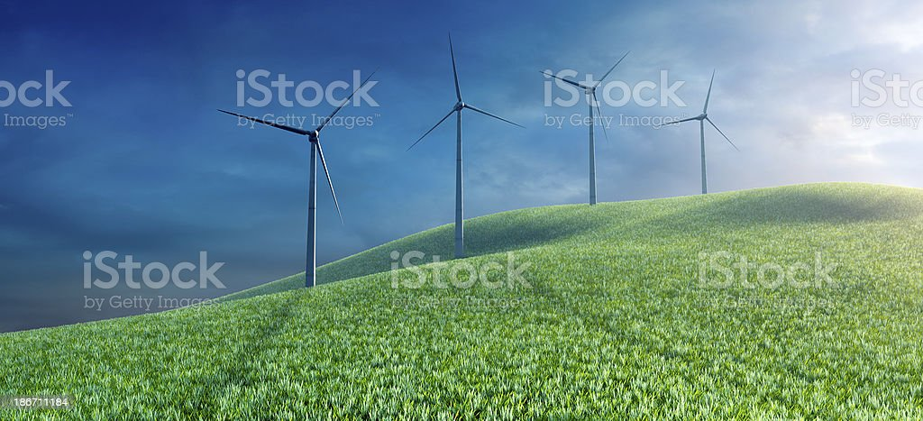 Wind turbines on the top of grass field royalty-free stock photo