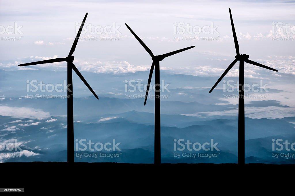 Wind Turbines Overlooking a Mountain Range stock photo