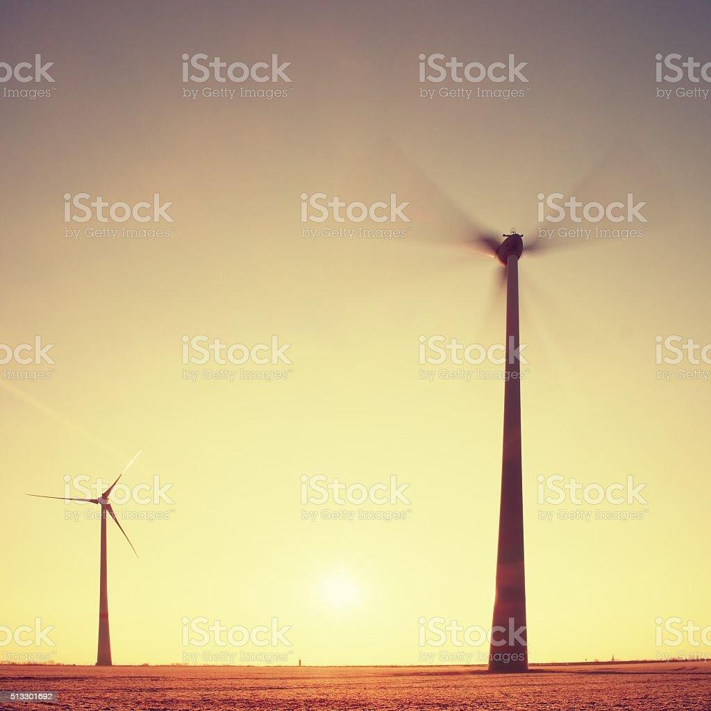 Wind Turbines Producing Energy. Vintage Style Toned effect stock photo