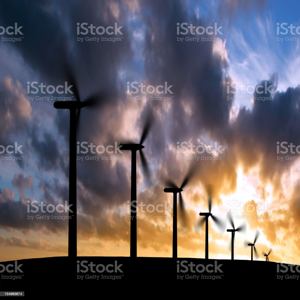 XL wind turbines silhouette stock photo
