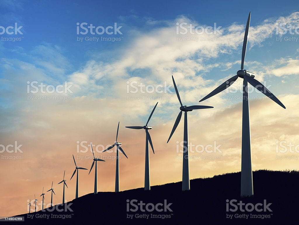 Wind turbines standing in a row stock photo