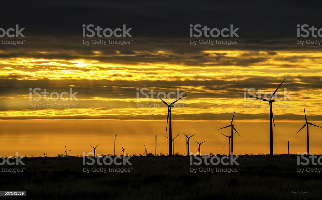 Wind Turbines. The Energy of the Sun within the Sunset stock photo