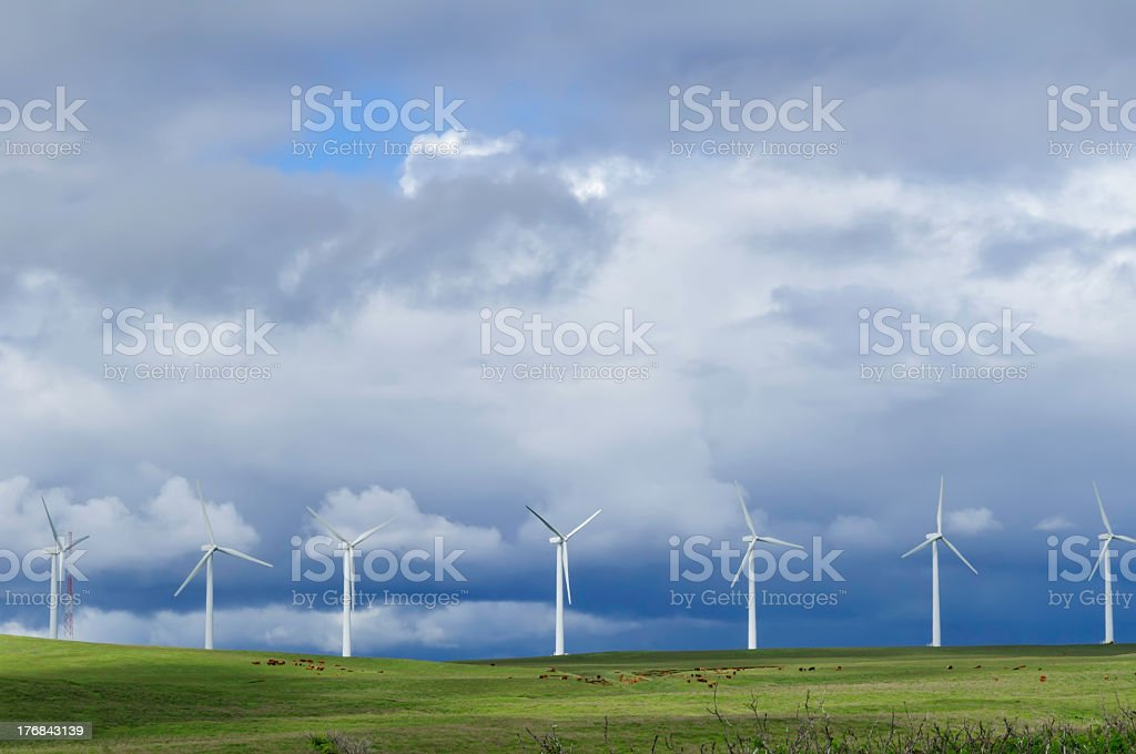 Wind turbines under moody sky before a storm stock photo