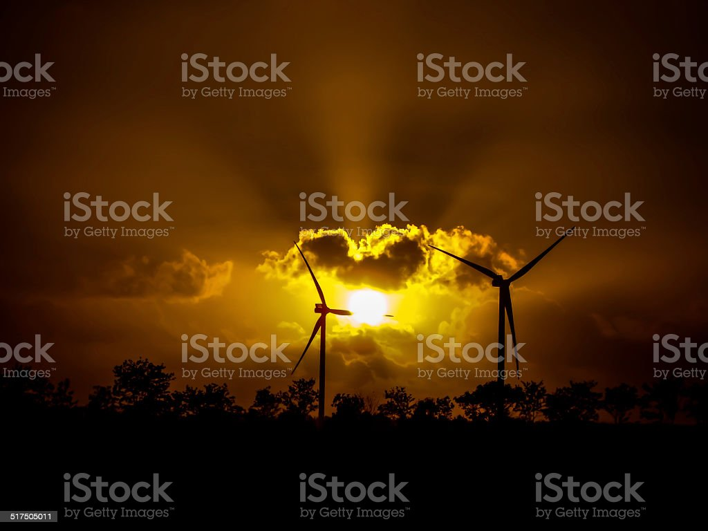 Wind turbines with nice clouds and sunbeam stock photo