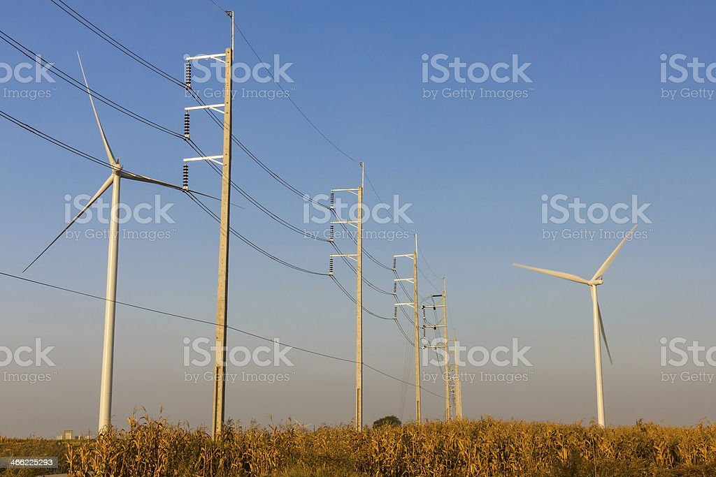 Wind turbines with transmission lines stock photo