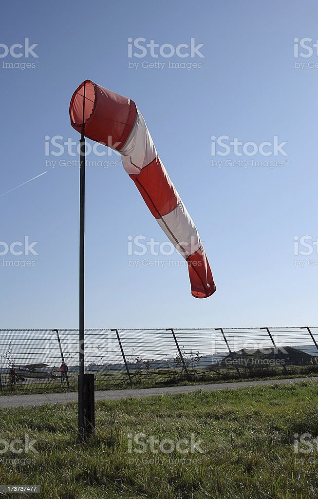 Wind vane at the airport and blue background stock photo