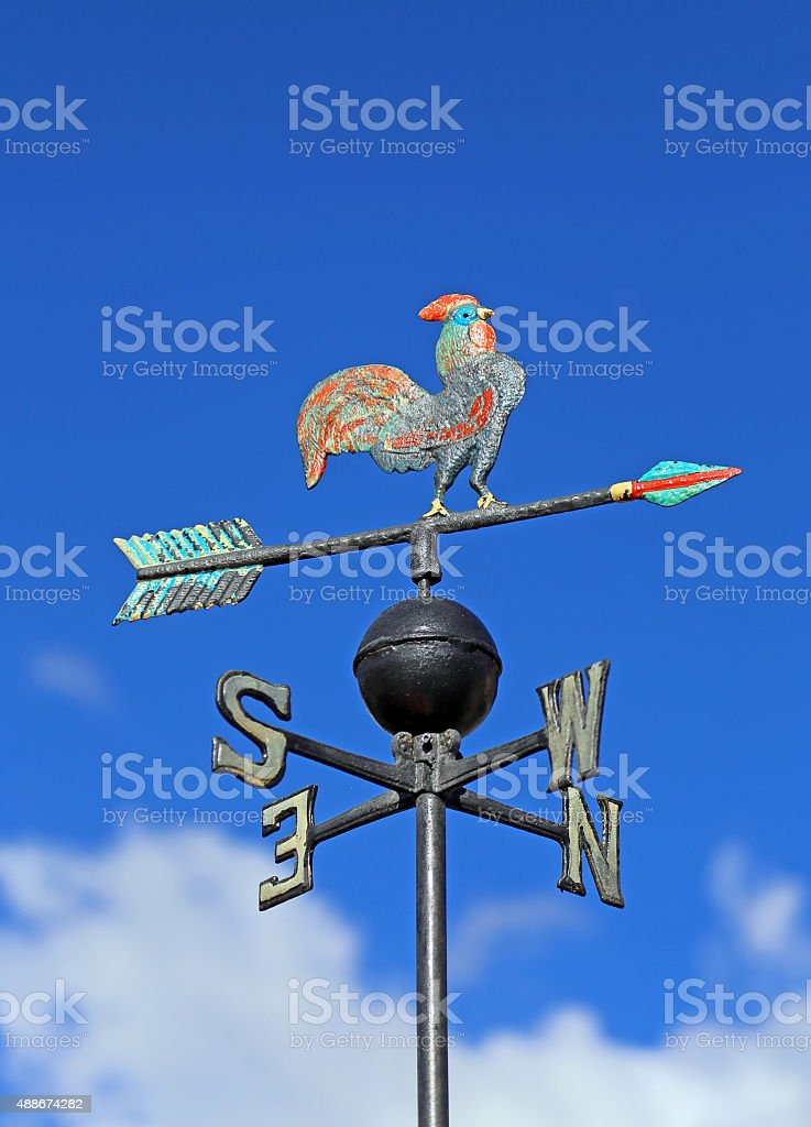 wind vane for measuring wind direction with a cock stock photo