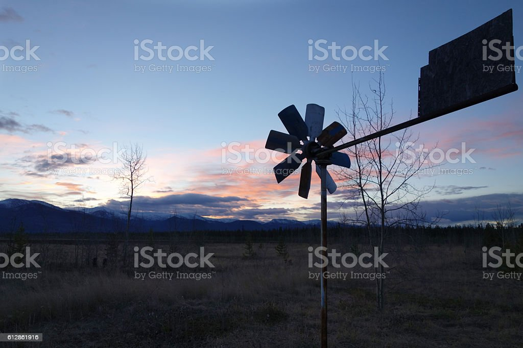 Wind vane in early morning light in a desolate landscape stock photo