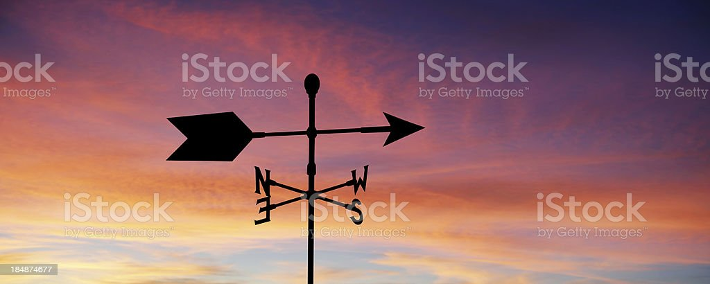 XXL wind vane silhouette stock photo