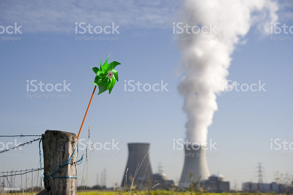 Wind versus nuclear energy stock photo