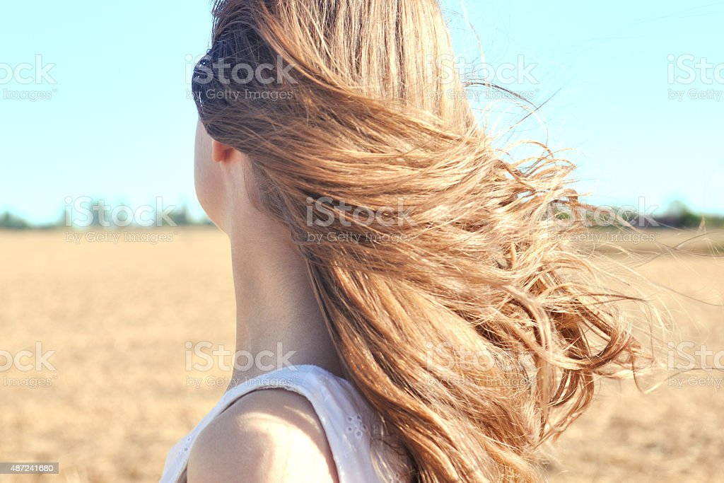 Wind whips through young girls hair stock photo