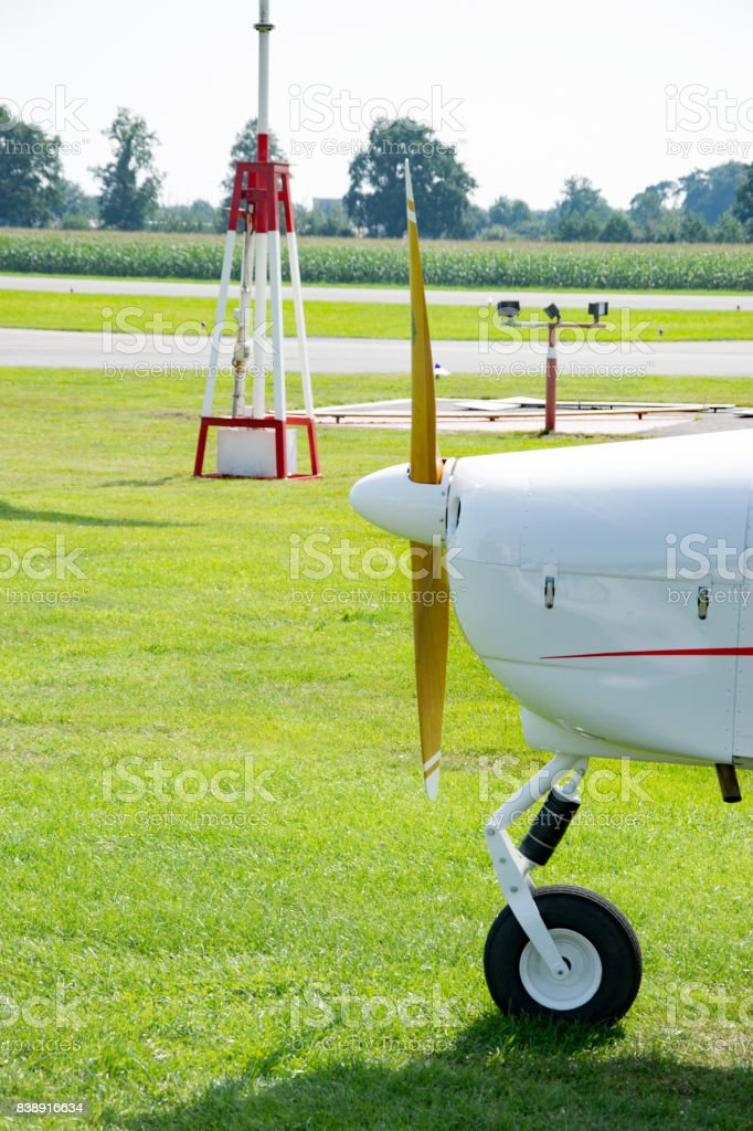 Windbag and small aircraft at an airport in Germany stock photo