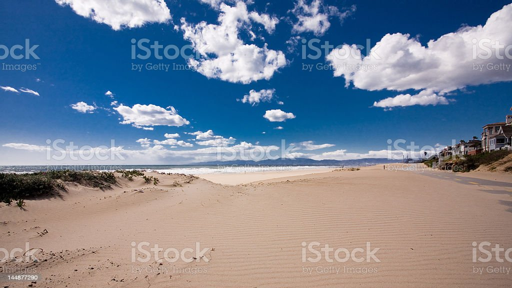 windblown sand on The Strand stock photo