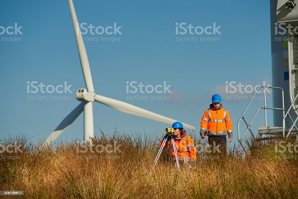 windfarm power engineers stock photo