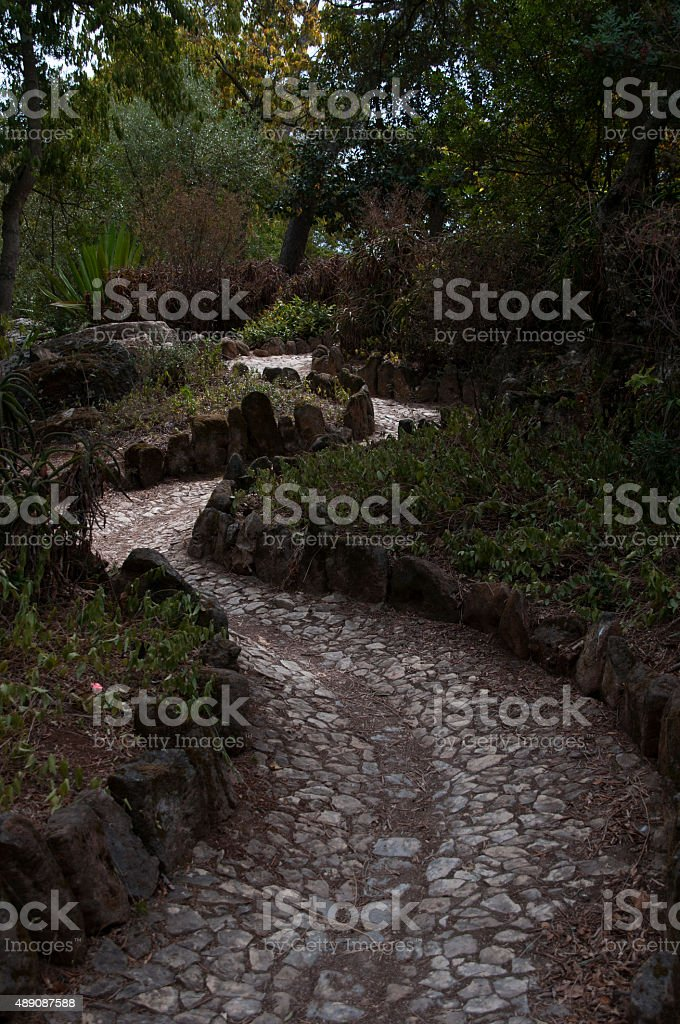 Winding cobbled path of Cascais Park royalty-free stock photo