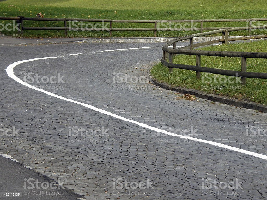 Winding cobbled road royalty-free stock photo