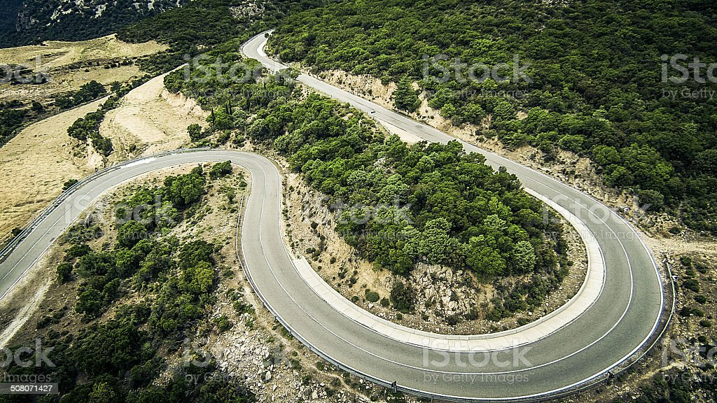 winding country road in sardinia's mountains stock photo