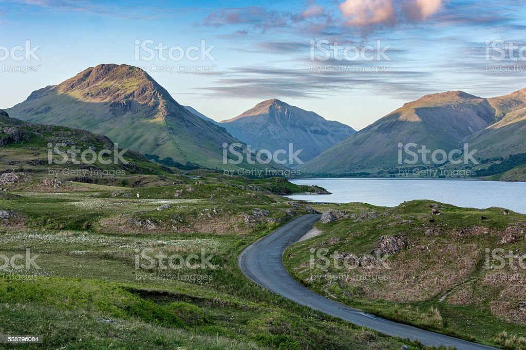Winding Country Road With Beautiful Light On Mountains. stock photo