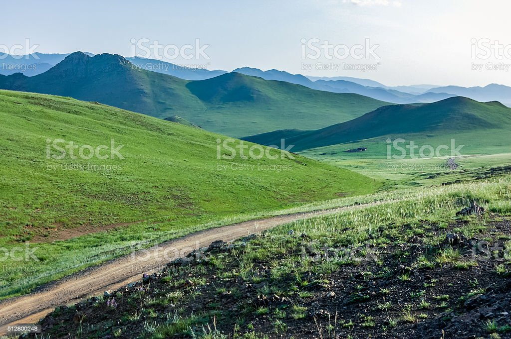 Winding dirt road, central Mongolian steppe stock photo