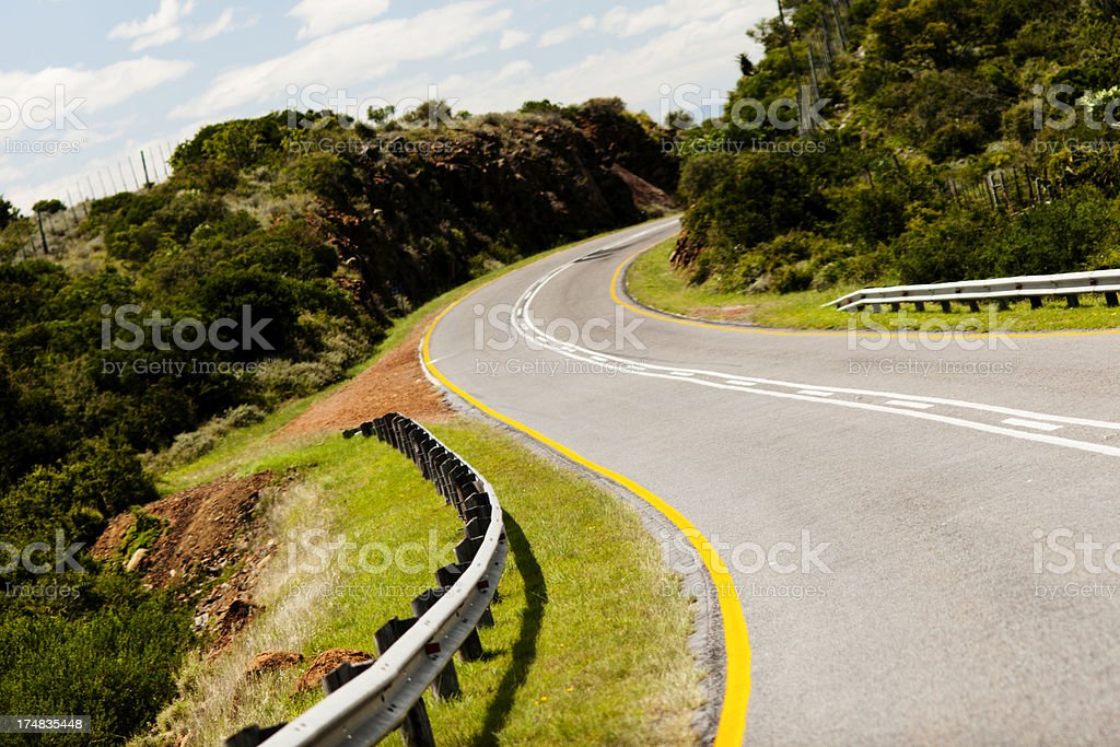 winding empty road through hills royalty-free stock photo
