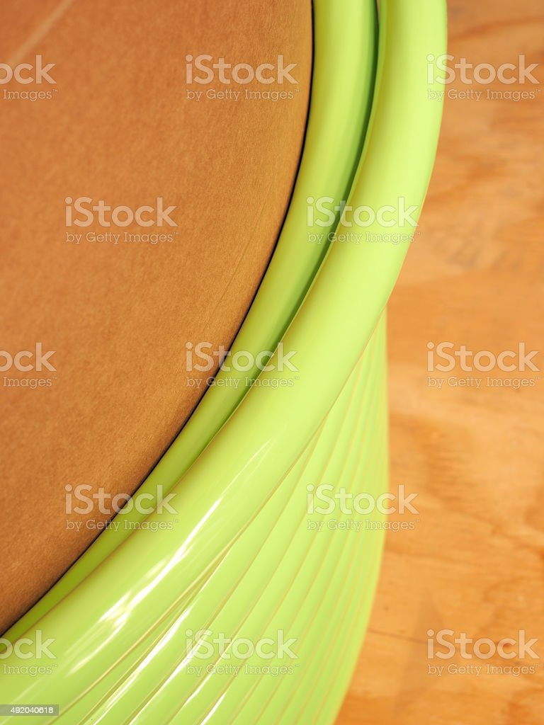 Winding layer of green cable on a cardboard core stock photo