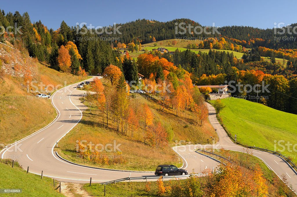 Winding mountain road colorful autumn landscape blue sky stock photo