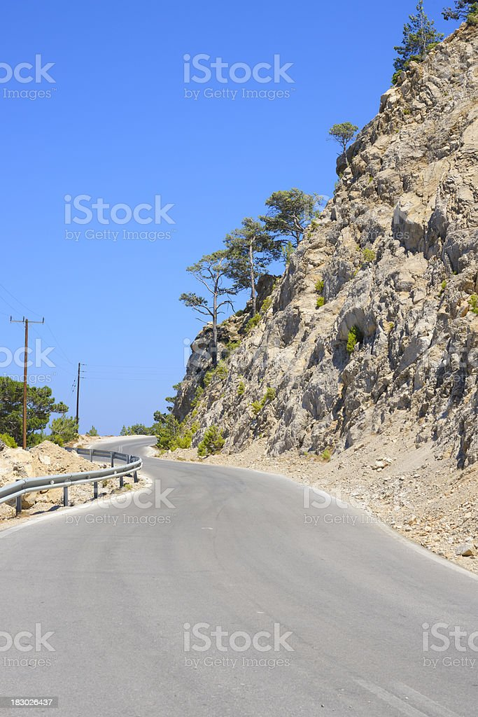 Winding Mountain Road in Summer with Clear Blue Sky royalty-free stock photo