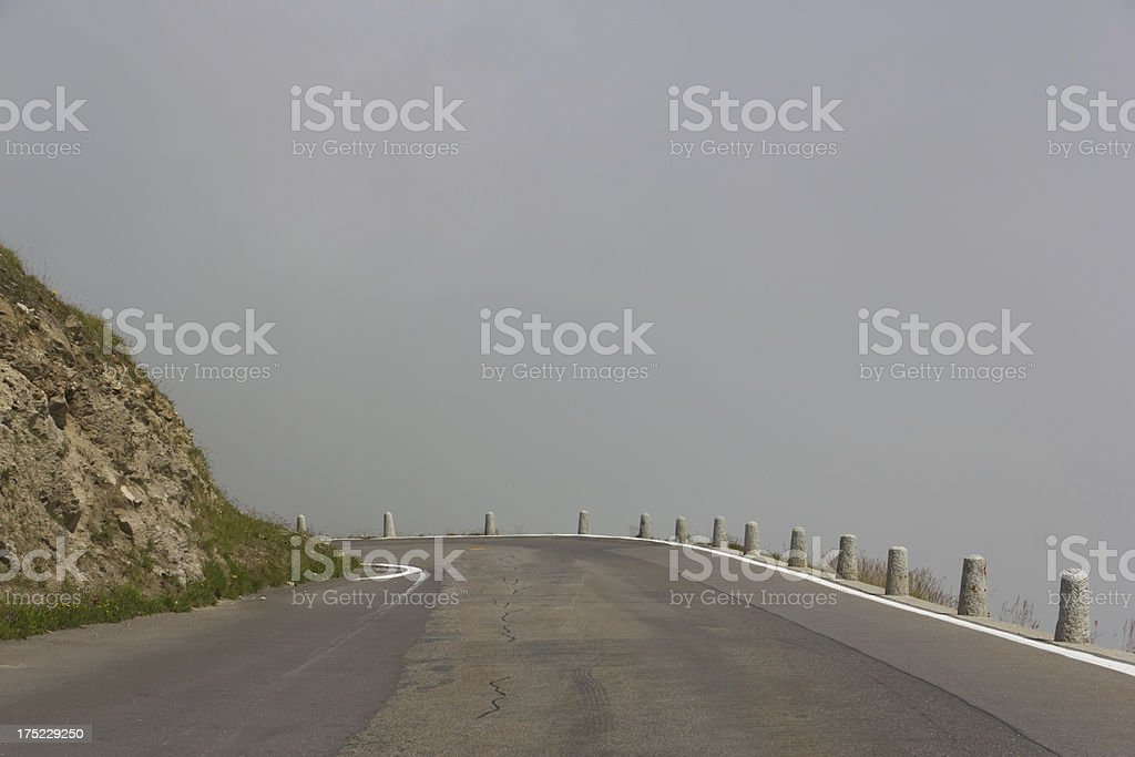 winding mountain road in the Alps royalty-free stock photo