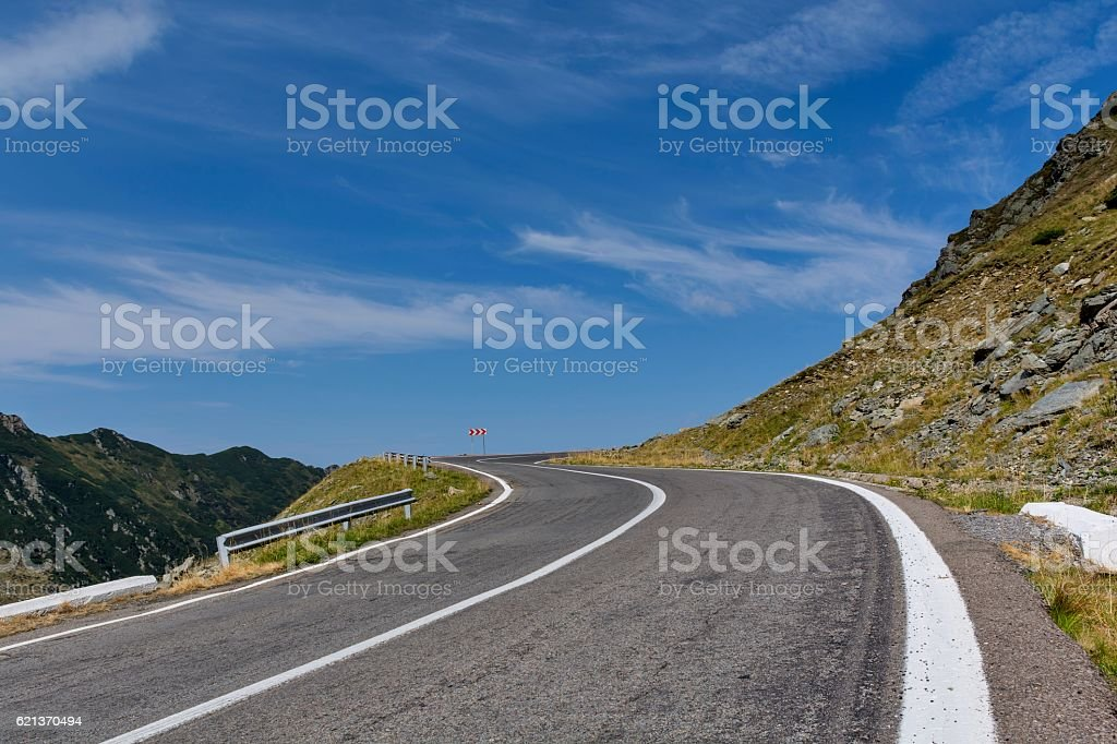 Winding mountain road with dangerous curves in Carpathian mountains. stock photo