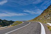 Winding mountain road with dangerous curves in Carpathian mountains.