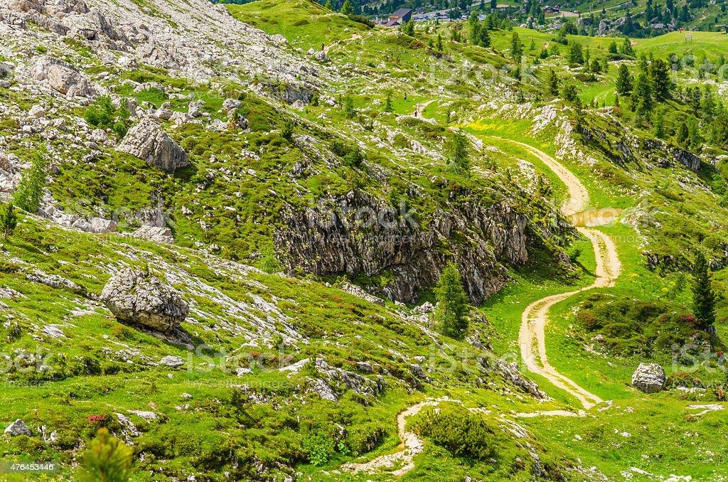 Winding path of Dolomites Mountains, Italy stock photo