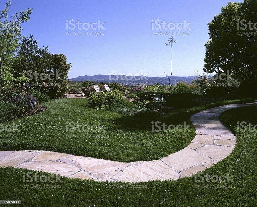 Winding path through a beautiful yard royalty-free stock photo