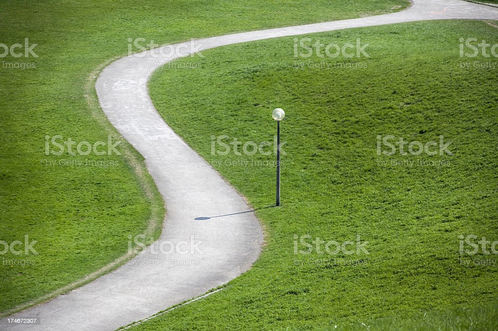 Winding path with street light royalty-free stock photo