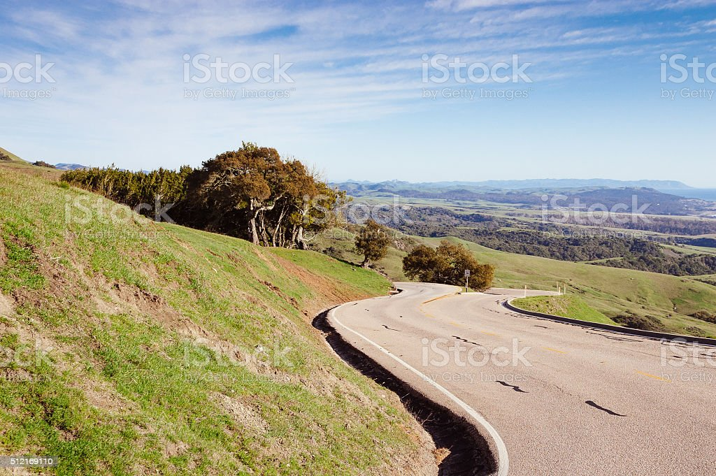 Winding road along the rolling hills near San Simeon, CA stock photo