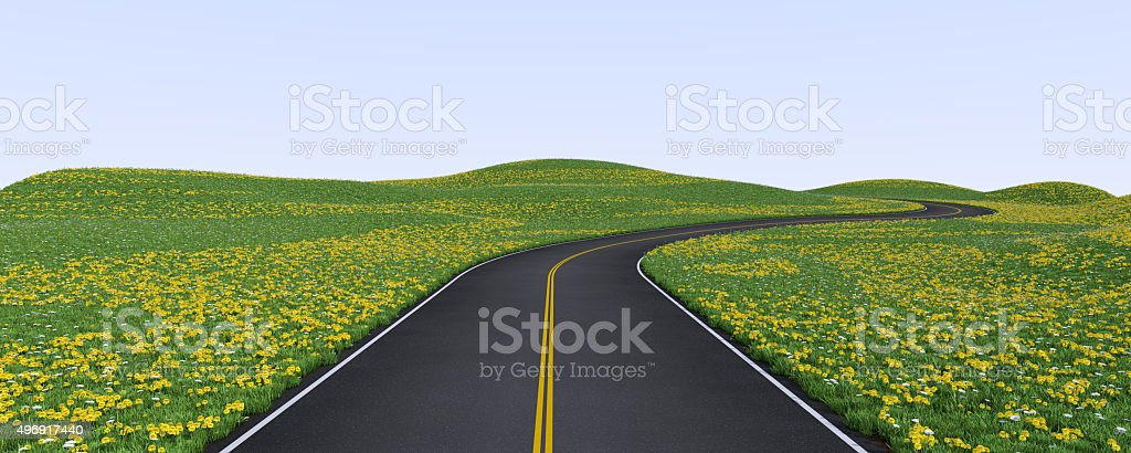 Winding road among green hills stock photo