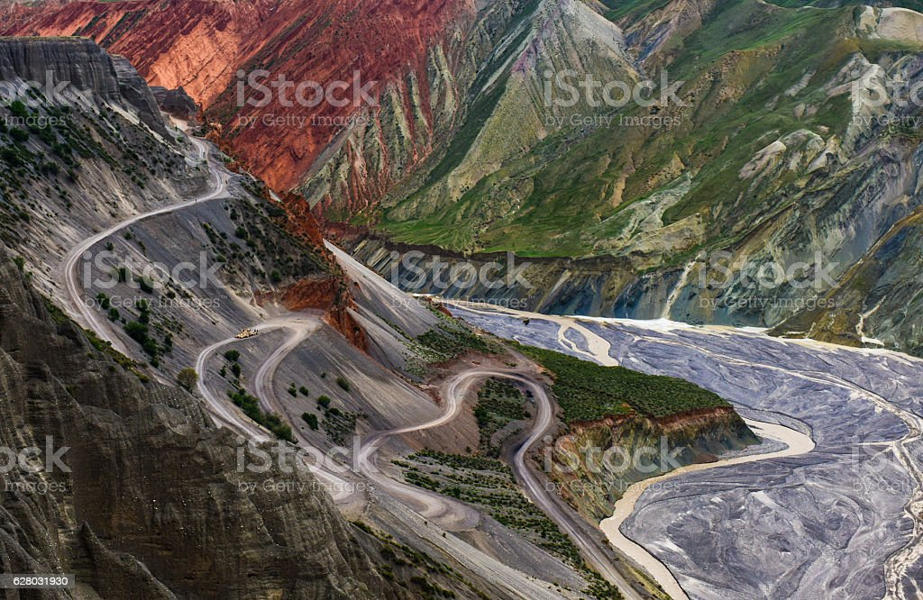 Winding road and River In a deep valley, stock photo
