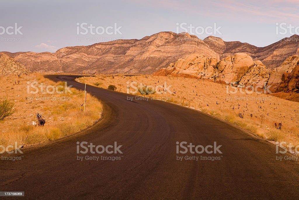 Winding road at sunrise royalty-free stock photo