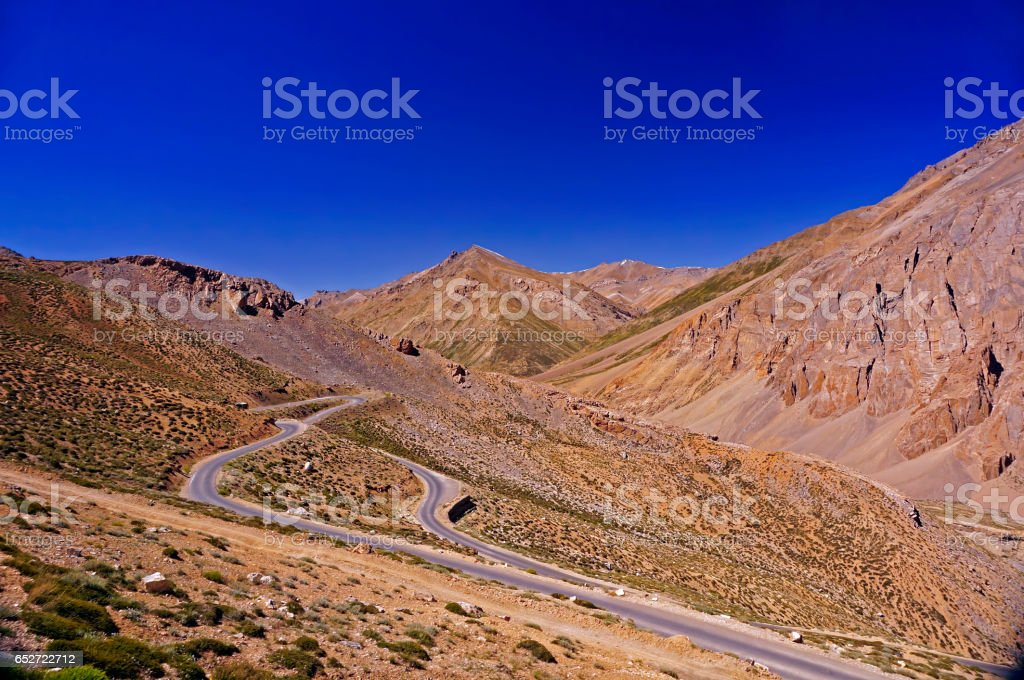 Winding Road in the High-Altitude Mountain Region of Ladakh in the Himalayas stock photo