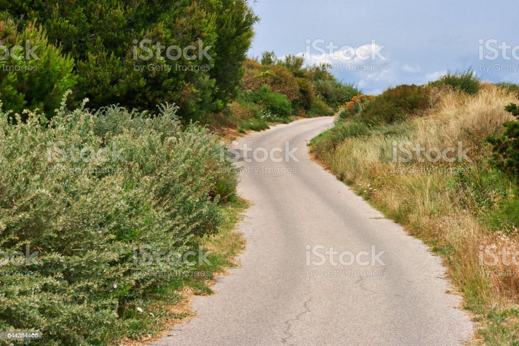 winding road in the hills stock photo