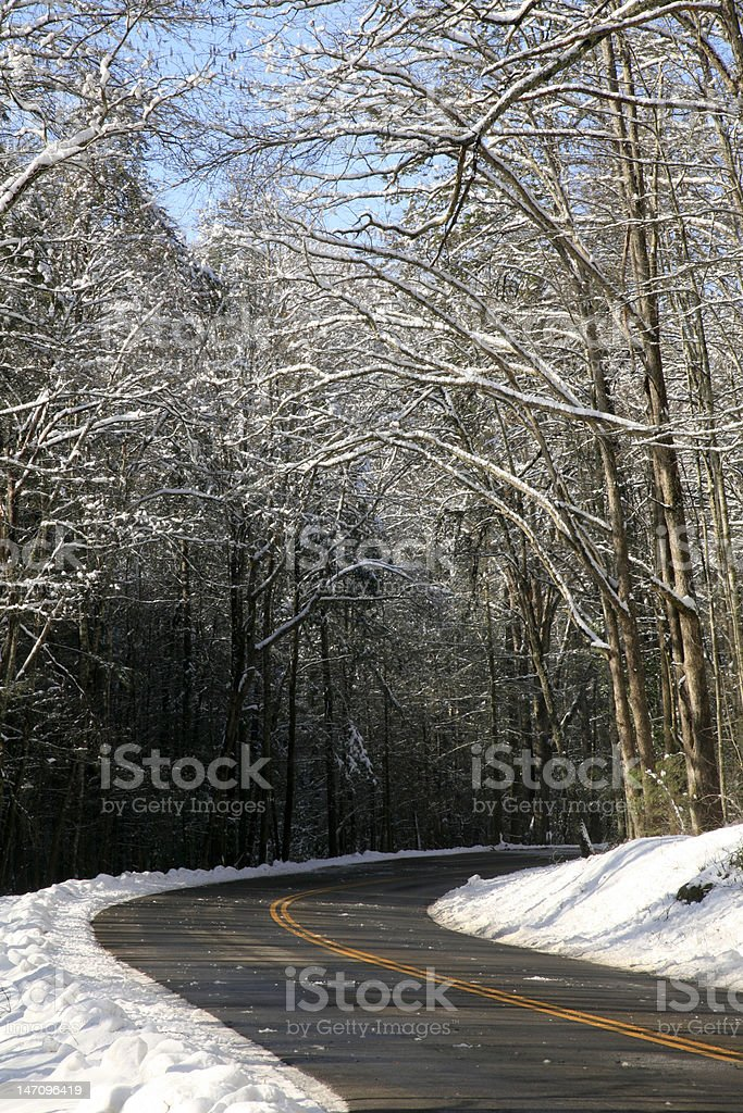 winding road in winter snow stock photo