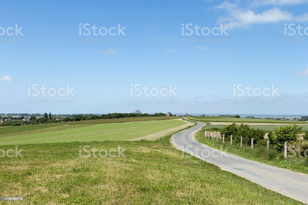 Winding road on a field royalty-free stock photo