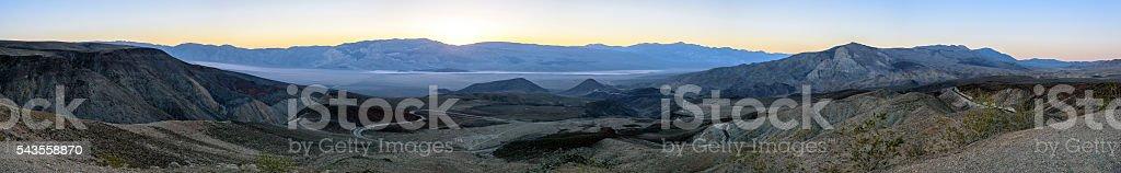Winding road through desert landscape stock photo