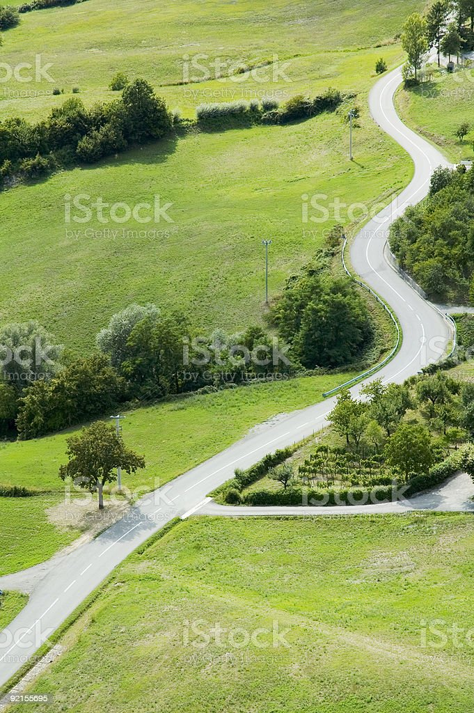 winding road through hilly country side royalty-free stock photo