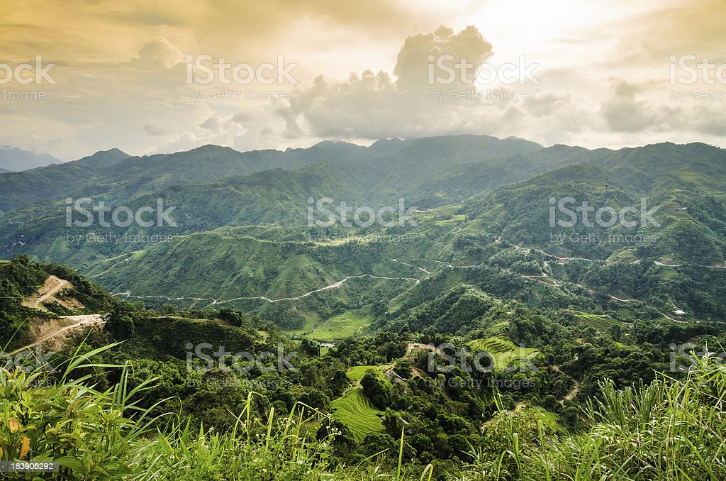 Winding road through mountainside in cloudy day royalty-free stock photo