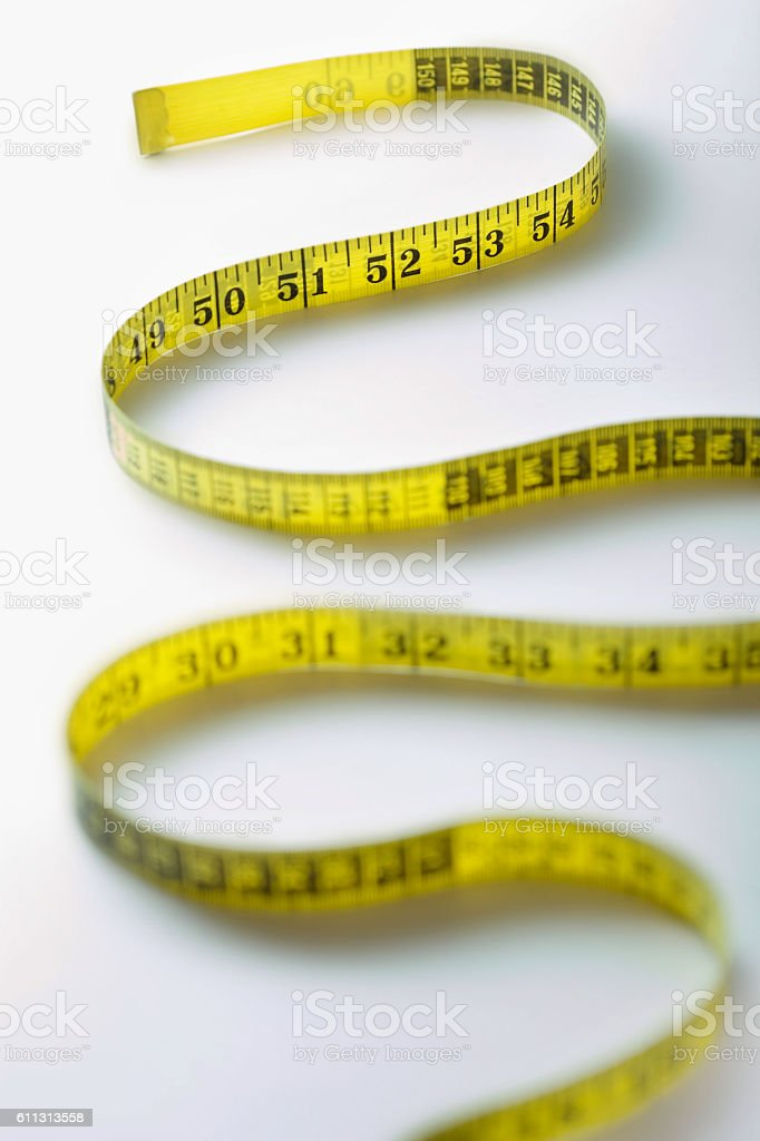 Winding Strip of Measuring Tape stock photo