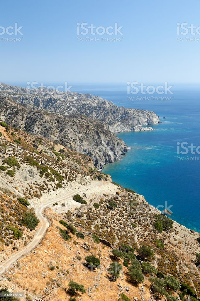 Winding unpaved road in Greece stock photo