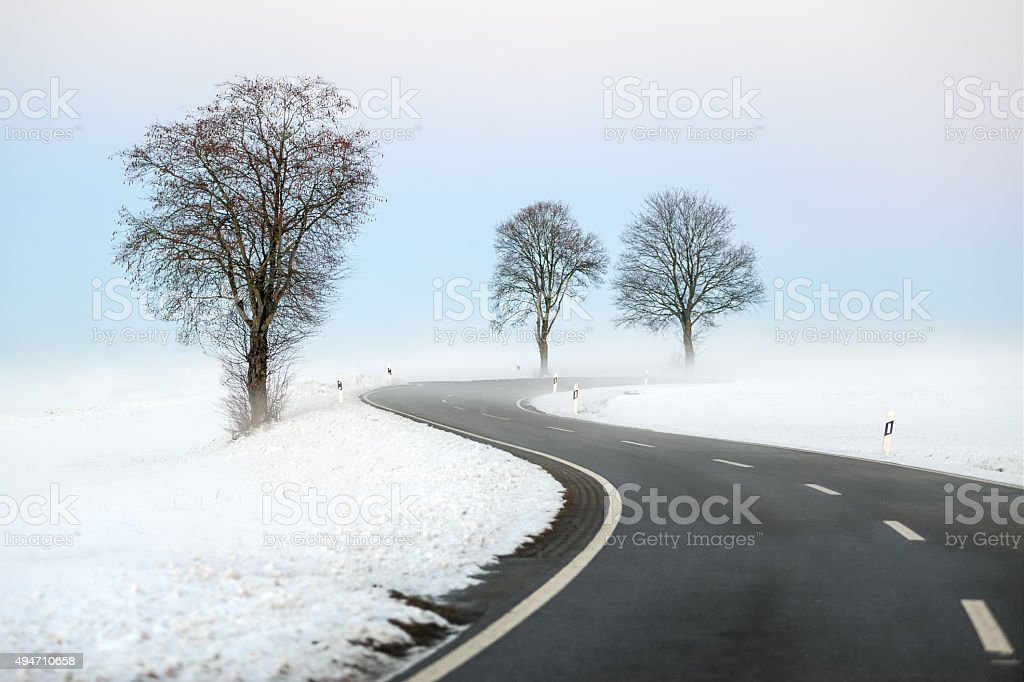 Winding winter road stock photo