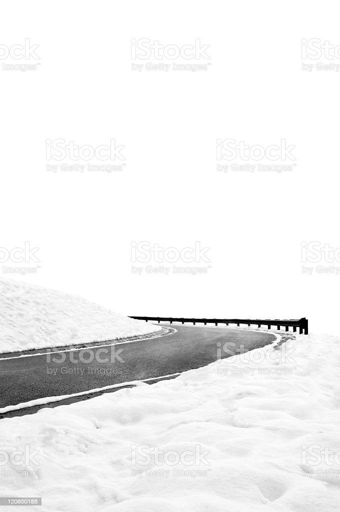 Winding winter road to nowhere stock photo