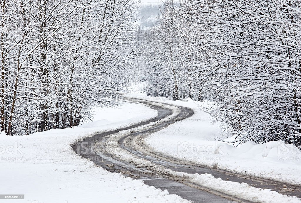Winding Winter Road With Snow Slush and Ice stock photo