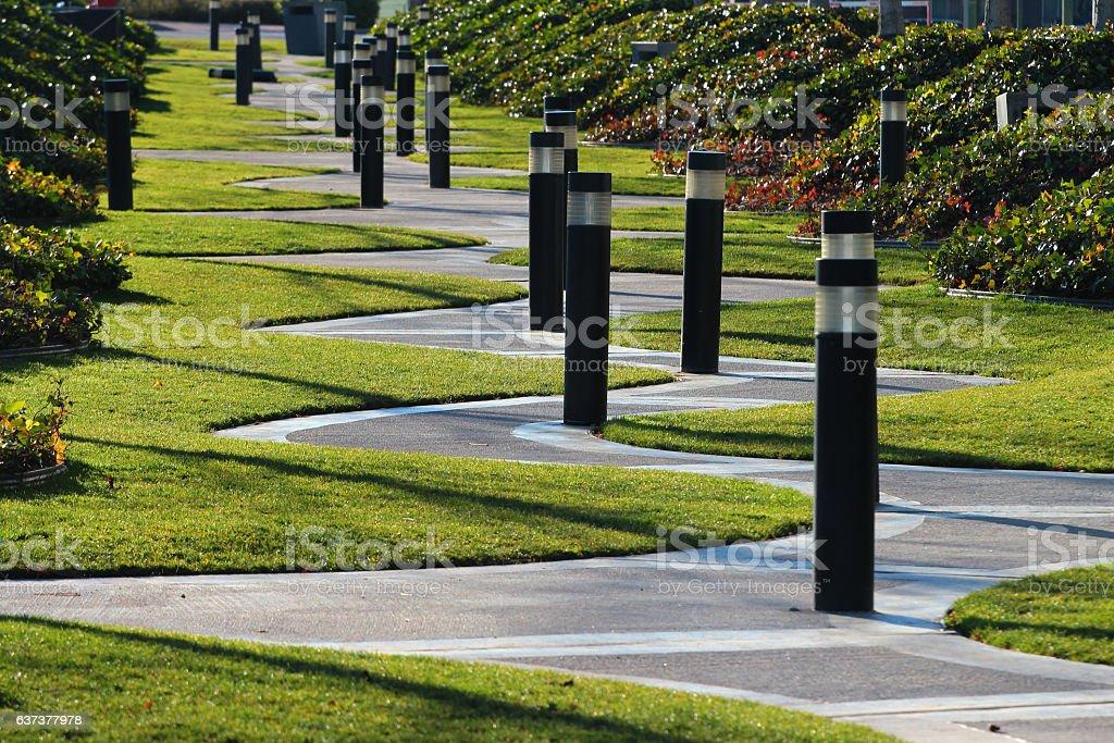 Winding zigzag walkway in a park, Madrid, Spain. stock photo
